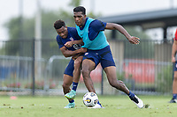 FRISCO, TX - JULY 20: Jonathan Lewis, Donovan Pines battle for a ball during a training session at Toyota Soccer Center FC Dallas on July 20, 2021 in Frisco, Texas.