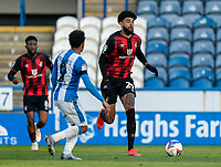 13th April 2021; The John Smiths Stadium, Huddersfield, Yorkshire, England; English Football League Championship Football, Huddersfield Town versus Bournemouth; Philip Billing of Bournemouth takes on Duane Holmes of Huddersfield Town