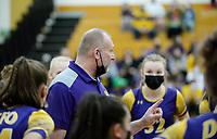 DeForest head coach, Scott Schumann, talks to players before the first set on Saturday, as DeForest tops Waunakee 3 sets to 1 in Wisconsin WIAA girls high school volleyball regional finals on Sat., Apr. 10, 2021 at DeForest High School