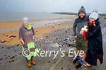 Niamh Murphy, Petr Dobes and Sandra Martin from Fenit have the hot water bottle to the ready after their swim in Fenit on Saturday morning.