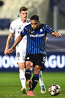 Luis Muriel of Atalanta BC and Toni Kroos of Real Madrid compete for the ball during the Champions League round of 16 football match between Atalanta BC and Real Madrid at Atleti azzurri d'Italia stadium in Bergamo (Italy), February, 24th, 2021. Photo Image Sport  / Insidefoto