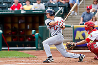 Clay Fuller (12) of the Arkansas Travelers follows through on his swing during a game against the Springfield Cardinals on May 10, 2011 at Hammons Field in Springfield, Missouri.  Photo By David Welker/Four Seam Images.