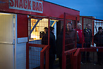 Witton Albion 1 Warrington Town 2, 26/12/2017. Wincham Park, Northern Premier League. Spectators at the snack bar watching the second half action at Wincham Park, home of Witton Albion (in red) during their Northern Premier League premier division fixture with Warrington Town. Formed in 1887, the home team have played at their current ground since 1989 having relocated from the Central Ground in Northwich. With both team chasing play-off spots, the visitors emerged with a 2-1 victory, the winner being scored by Tony Gray in second half injury time, watched by a crowd of 503. Photo by Colin McPherson.
