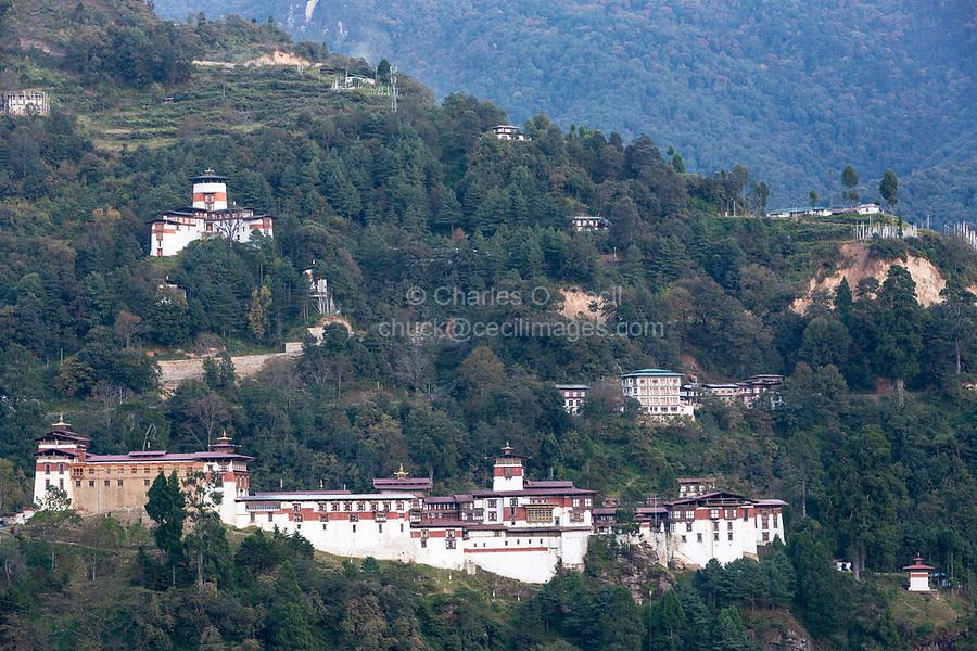 Trongsa, Bhutan.  Trongsa Dzong (Monastery-Fortress) in Late Afternoon.  Trongsa Royal Heritage Museum upper left.