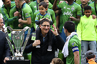 SEATTLE, WA - NOVEMBER 10: Seattle Sounders FC owner Adrian Hanauer shares a moment with team captain Nicolas Lodeiro #10 just before they were awarded the Philip F. Anschutz Trophy during a game between Toronto FC and Seattle Sounders FC at CenturyLink Field on November 10, 2019 in Seattle, Washington.