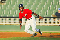 Tim Anderson (2) of the Kannapolis Intimidators takes off for second base against the Greensboro Grasshoppers at CMC-Northeast Stadium on July 15, 2013 in Kannapolis, North Carolina.  The Intimidators defeated the Grasshoppers 4-0.   (Brian Westerholt/Four Seam Images)