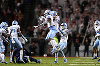 RALEIGH, NC - NOVEMBER 30: Trey Morrison #4 of the University of North Carolina celebrates intercepting the ball with Javon Terry #6 during a game between North Carolina and North Carolina State at Carter-Finley Stadium on November 30, 2019 in Raleigh, North Carolina.
