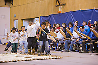 Young Inupiaq children imitate a dance that tells the story of a Bowhead whale hunt during the Nalukataq festival, celebrating a successful spring subsistence whale hunt, in Utqiagvik (Barrow), Alaska.