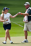 CHON BURI, THAILAND - FEBRUARY 17:  Morgan Pressel of USA celebrates with her caddie on 15th green during day one of the LPGA Thailand at Siam Country Club on February 17, 2011 in Chon Buri, Thailand.  Photo by Victor Fraile / The Power of Sport Images