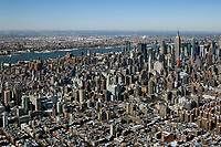 aerial photograph mid town Manhattan skyline, New York City toward the Hudson River and New Jersey after a winter storm
