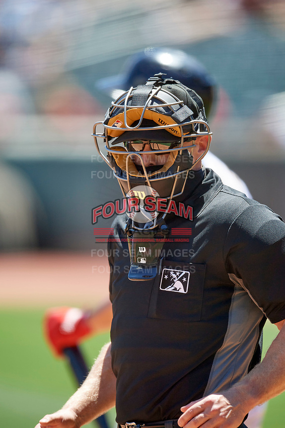Umpire Brian Walsh handles the calls behind the plate during the game between the Salt Lake Bees and the Round Rock Express at Smith's Ballpark on May 31, 2021 in Salt Lake City, Utah. The Express defeated the Bees 8-6. (Stephen Smith/Four Seam Images)