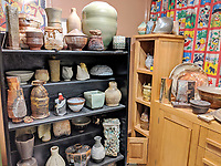 BNPS.co.uk (01202 558833)<br /> Pic: AdamPartridgeAuctioneers/BNPS<br /> <br /> Pictured: Shelves in the pot room<br /> <br /> A huge collection of pottery and ceramics found stacked inside the suburban home of an elderly couple has sold for almost £200,000.<br /> <br /> Leonard and Alison Shurz filled every room of their three bed house with ceramic pieces they had gathered from all over the world.<br /> <br /> The Aladdin's Cave of pots, bowls, plates, vases and jugs was found by a stunned auctioneer who had the daunting task of cataloguing it all.