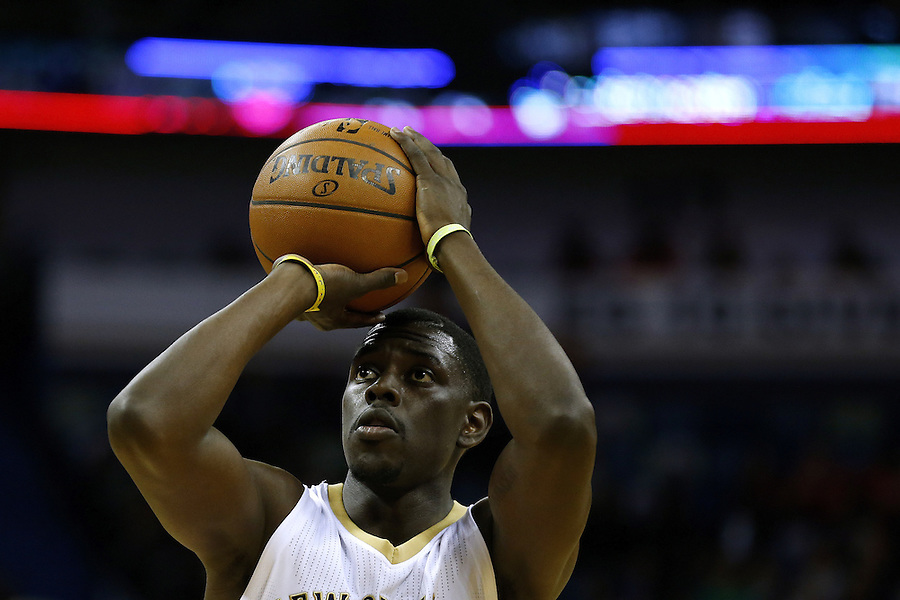 New Orleans Pelicans guard Jrue Holiday (11) shoots the ball during the first half of an NBA basketball game Saturday, Feb. 27, 2016, in New Orleans. (AP Photo/Jonathan Bachman)