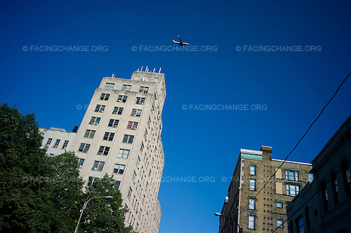Scranton, Pennsylvania.August 2, 2012..Passenger aircraft flies low over downtown on approach to land at Scranton Airport...Photograph by Alan Chin.