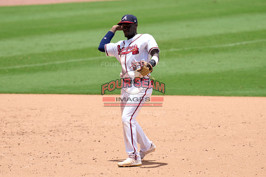 FCL Braves shortstop Francisco Floyd (4) throws the ball to first base during a game against the FCL Orioles Orange on July 22, 2021 at the CoolToday Park in North Port, Florida.  (Mike Janes/Four Seam Images)