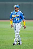 Jorge Alfaro (24) of the Myrtle Beach Pelicans warms up in the outfield prior to the game against the Winston-Salem Dash at BB&T Ballpark on May 7, 2014 in Winston-Salem, North Carolina.  The Pelicans defeated the Dash 5-4 in 11 innings.  (Brian Westerholt/Four Seam Images)