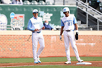 CHAPEL HILL, NC - FEBRUARY 27: Head coach Scott Forbes #21 and Justice Thompson #20 of North Carolina at third base during a game between Virginia and North Carolina at Boshamer Stadium on February 27, 2021 in Chapel Hill, North Carolina.