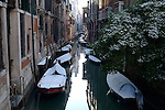 Boats on Canal in Venice, Italy.