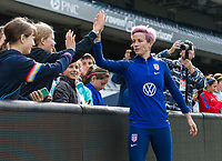 CHICAGO, IL - OCTOBER 5: Megan Rapinoe #15 of the United States high fives a fan at Soldier Field on October 5, 2019 in Chicago, Illinois.