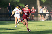 NEWTON, MA - MAY 14: Kessina Heyn #31 of Temple University brings the ball forward during NCAA Division I Women's Lacrosse Tournament first round game between University of Massachusetts and Temple University at Newton Campus Lacrosse Field on May 14, 2021 in Newton, Massachusetts.