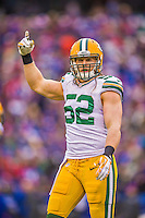 14 December 2014: Green Bay Packers outside linebacker Clay Matthews signals the bench in the first quarter against the Buffalo Bills at Ralph Wilson Stadium in Orchard Park, NY. The Bills defeated the Packers 21-13, snapping the Packers' 5-game winning streak and keeping the Bills' 2014 playoff hopes alive. Mandatory Credit: Ed Wolfstein Photo *** RAW (NEF) Image File Available ***