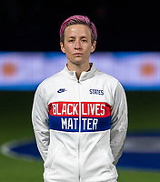 ORLANDO, FL - FEBRUARY 24: Megan Rapinoe #15 of the USWNT stands for the national anthem before a game between Argentina and USWNT at Exploria Stadium on February 24, 2021 in Orlando, Florida.
