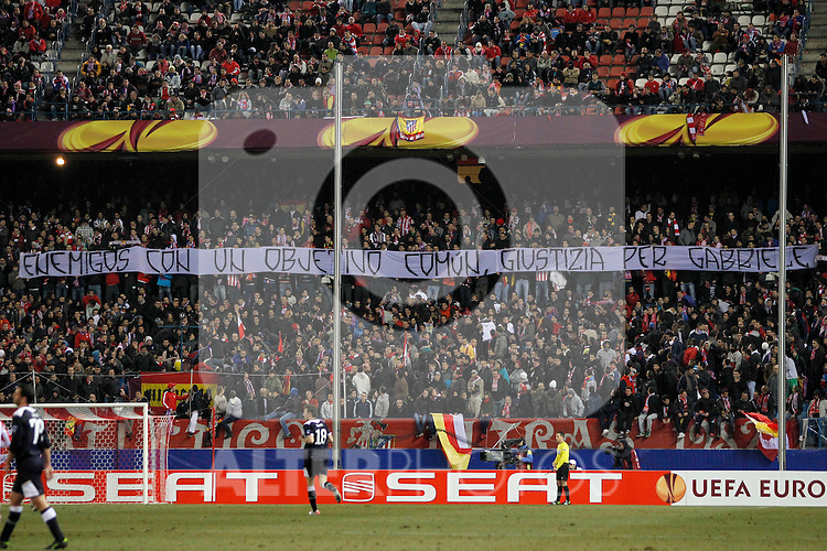 """Atletico de Madrid's supporters carry a banner with the slogan """"enemies with a common target, justice for Gabriele"""" during Europa League match.February 23,2012. (ALTERPHOTOS/Acero)"""