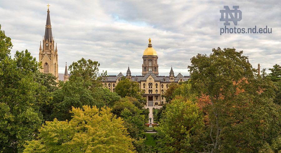 September 28, 2017; Fall foliage over the Main Quad with the Main Building and Basilica of the Sacred Heart bathed in early morning light.  (Photo by Barbara Johnston/University of Notre Dame)
