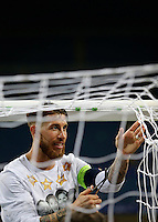 Calcio, finale di Champions League: Real Madrid vs Atletico Madrid. Stadio San Siro, Milano, 28 maggio 2016.<br /> Real Madrid's Sergio Ramos cuts the goal net at the end of the Champions League final match against Atletico Madrid, at Milan's San Siro stadium, 28 May 2016. Real Madrid won 5-4 on penalties after the game ended 1-1.<br /> UPDATE IMAGES PRESS/Isabella Bonotto