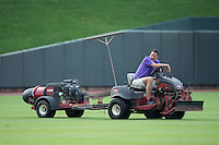 Winston-Salem Dash President Geoff Lassiter uses a jet dryer to try and remove water from the outfield prior to the game against the Myrtle Beach Pelicans at BB&T Ballpark on July 7, 2016 in Winston-Salem, North Carolina.  The Dash defeated the Pelicans 13-9.  (Brian Westerholt/Four Seam Images)