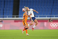 YOKOHAMA, JAPAN - JULY 30: Lindsey Horan #9 of the United States goes up for a header with Danielle van de Donk #10 of the Netherlands during a game between Netherlands and USWNT at International Stadium Yokohama on July 30, 2021 in Yokohama, Japan.