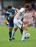 Sam Wood of Wycombe Wanderers tackles Callum Reynolds of Aldershot Town during the Friendly match between Aldershot Town and Wycombe Wanderers at the EBB Stadium, Aldershot, England on 26 July 2016. Photo by Alan  Stanford.