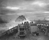 Coast Guardsmen on the deck of the U.S. Coast Guard Cutter Spencer watch the explosion of a depth charge which blasted a Nazi U-boat's hope of breaking into the center of a large convoy.  Sinking of U-175, April 17, 1943.  WO Jack January.  (Coast Guard)<br /> NARA FILE #:  026-G-1517<br /> WAR & CONFLICT BOOK #:  970