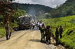 COL - Guerrillas members of the National Liberation Army (ELN) attack a bus in Colombia's routes