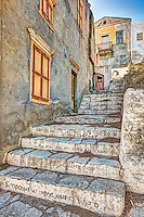 Steps with wise phrases at the upper town (Chorio) of Symi island, Greece