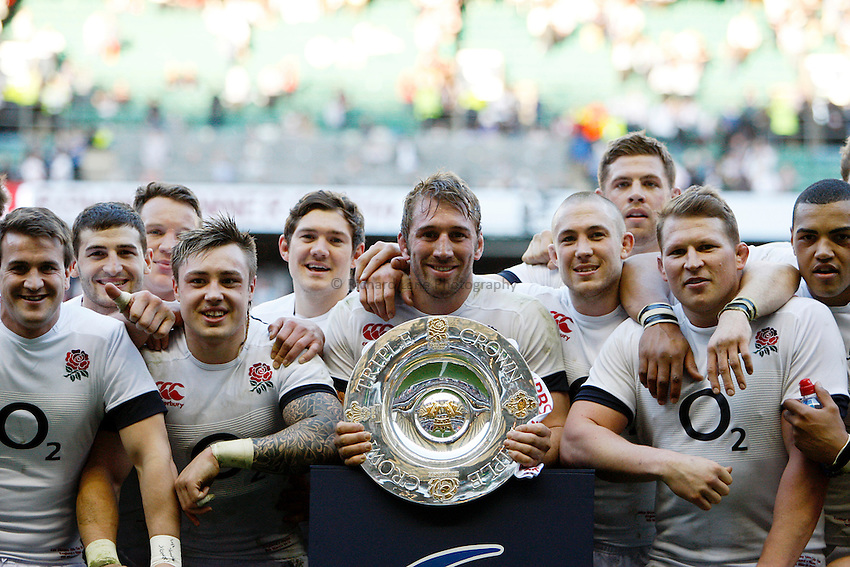 Photo: Richard Lane/Richard Lane Photography. England v Wales. RBS Six Nations. 09/03/2014. England captain, Chris Robshaw and his team celebrate victory with the Triple Crown presentation.