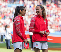 PARIS,  - JUNE 16: Christen Press #23 and Tierna Davidson #12 stand for the national anthem during a game between Chile and USWNT at Parc des Princes on June 16, 2019 in Paris, France.