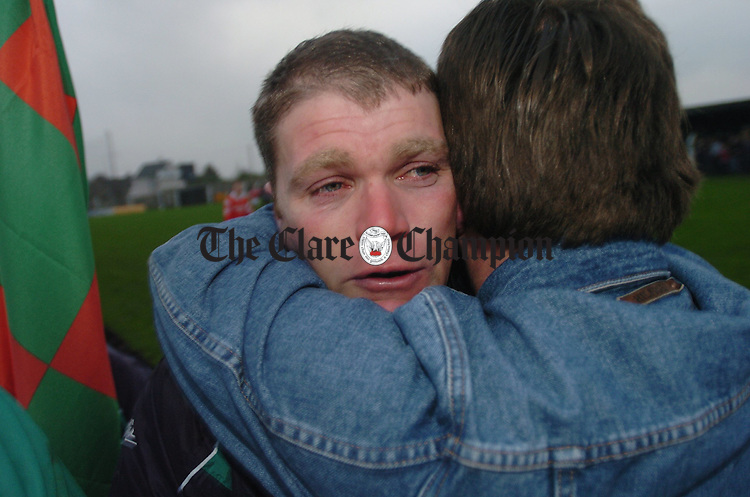 An emotional John O Connor of Kilmurry Ibrickane, who had been sent off,  is congratulated by a fan after the final whistle. Photograph by John Kelly.