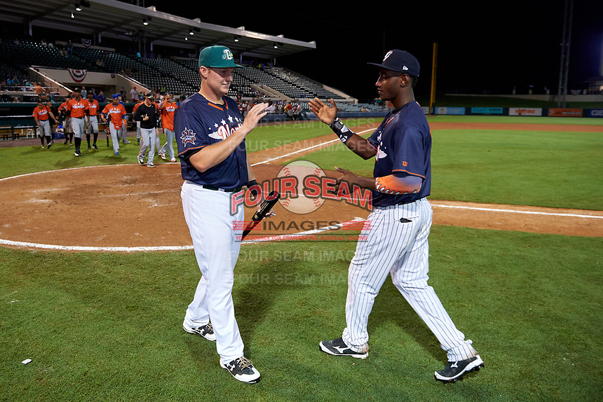 Daytona Tortugas Gavin LaValley (32) shakes hands with Jorge Mateo (right) after being awarded the game MVP Award during the Florida State League All-Star Game on June 17, 2017 at Joker Marchant Stadium in Lakeland, Florida.  FSL North All-Stars defeated the FSL South All-Stars  5-2.  (Mike Janes/Four Seam Images)
