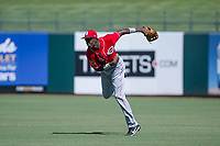 Cincinnati Reds right fielder Mariel Bautista (60) follows through on a throw to third base during an Instructional League game against the Kansas City Royals on October 2, 2017 at Surprise Stadium in Surprise, Arizona. (Zachary Lucy/Four Seam Images)