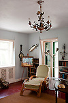 The easy chair sits in the best light in Hemingway's Study, at the Hemingway House, Key West, Florida, USA.