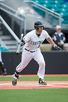 G.K. Young (37) of the Coastal Carolina Chanticleers follows through on his swing against the Bryant Bulldogs at Springs Brooks Stadium on March 13, 2015 in Charlotte, North Carolina.  The Chanticleers defeated the Bulldogs 7-2.  (Brian Westerholt/Four Seam Images)