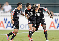 D.C. United defender Brandon McDonald (4) celebrates his score with teammates Marcelo Saragosa and Andy Najar. D.C. United defeated The Chicago Fire 4-2 at RFK Stadium, Wednesday August 22, 2012.