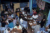 Sao Paulo, Brazil. Night life in Moema; people socialising in a cafe bar.