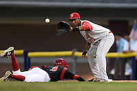 Brooklyn Cyclones first baseman Pedro Perez (10) waits for a throw as Ryan Aper (3) dives back to first during a game against the Batavia Muckdogs on August 11, 2014 at Dwyer Stadium in Batavia, New York.  Batavia defeated Brooklyn 4-3.  (Mike Janes/Four Seam Images)