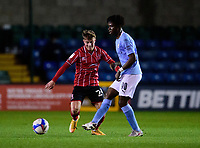 Lincoln City's Robbie Gotts vies for possession with  Manchester City U21's Romeo Lavia<br /> <br /> Photographer Andrew Vaughan/CameraSport<br /> <br /> EFL Papa John's Trophy - Northern Section - Group E - Lincoln City v Manchester City U21 - Tuesday 17th November 2020 - LNER Stadium - Lincoln<br />  <br /> World Copyright © 2020 CameraSport. All rights reserved. 43 Linden Ave. Countesthorpe. Leicester. England. LE8 5PG - Tel: +44 (0) 116 277 4147 - admin@camerasport.com - www.camerasport.com