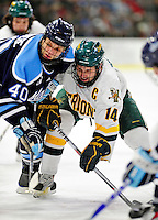 30 January 2010: University of Vermont Catamount forward Brian Roloff, a Senior from West Seneca, NY, takes a faceoff against the University of Maine Black Bears at Gutterson Fieldhouse in Burlington, Vermont. The Maine Black Bears and the Catamounts played to a 4-4 tie in the second game of their America East weekend series. Mandatory Credit: Ed Wolfstein Photo
