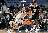 WASHINGTON, DC - FEBRUARY 19: Luwane Pipkins #12 of Providence blocks Terrell Allen #12 of Georgetown during a game between Providence and Georgetown at Capital One Arena on February 19, 2020 in Washington, DC.
