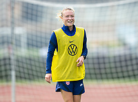 CLEVELAND, OH - SEPTEMBER 14: Emily Sonnett of the United States laughs during a training session at the training fields on September 14, 2021 in Cleveland, Ohio.