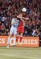 09 March 2013: Sporting KC defender Matt Besler #5 and Toronto FC midfielder Darel Russell #16 in action during an MLS game between Sporting Kansas City and Toronto FC at The Rogers Centre in Toronto, Ontario Canada..Toronto FC won 2-1.